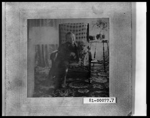 Primary view of object titled 'Picture of V. C. Perini, Jr. & Dog in a Rocking Chair'.