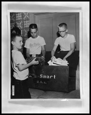 Primary view of object titled 'Rob Smart, Tom Perini and J. E. Matthews Packing for Camp'.