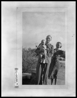 Primary view of object titled 'V. C. Jr. and Vee Perini, with Thile Walker Outside by Stone Bench'.