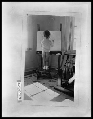 Primary view of object titled 'Vee Perini at Drawing Board'.