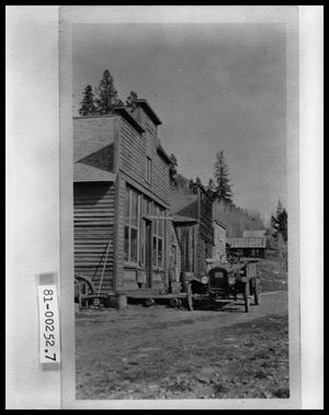 Primary view of object titled 'Exterior View of Old Post Office and Automobile'.