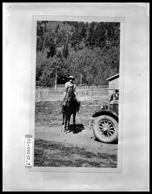 Primary view of object titled 'Horse and Rider, by Automobile'.