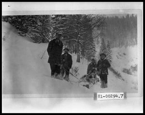 Primary view of object titled 'Four Men With Sled On Mountainside'.