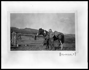 Primary view of object titled 'Man with Horse by Cabin'.