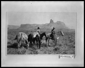 Two Men Traveling With Four Horses and Foal
