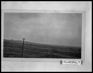 Primary view of object titled 'Field of Oil Wells and Power Lines'.