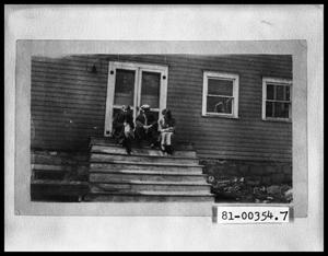 Primary view of object titled 'Man with Two Women on Porch Steps'.