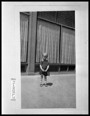 Primary view of object titled 'Child in Front of Store Display Windows'.