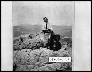 Primary view of object titled 'Man on Rock Mountain'.