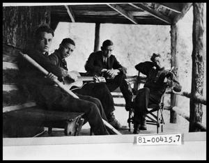 Primary view of object titled 'Four Men Sitting on Porch with Guitar'.