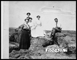 Primary view of object titled 'Four Women and One Man Outside on Rocks'.