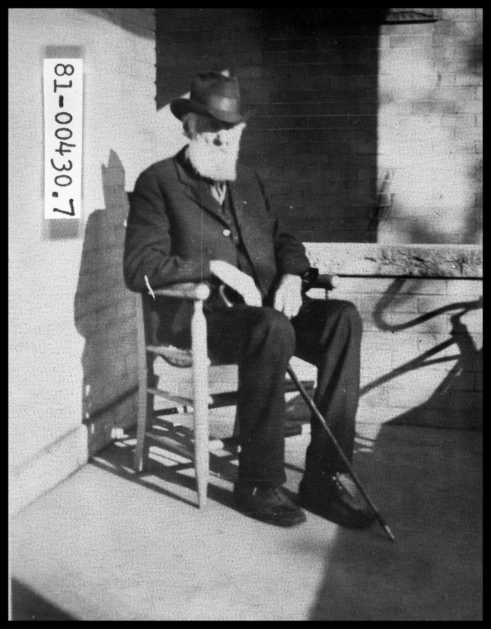 Old Man Sitting in Chair with Cane - The Portal to Texas History