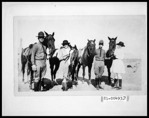 Primary view of object titled '[Photograph of Bud Perini and Others with Horses]'.