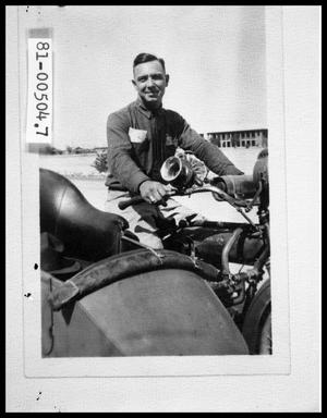 Primary view of object titled 'Man in Military Uniform on Motorcycle'.