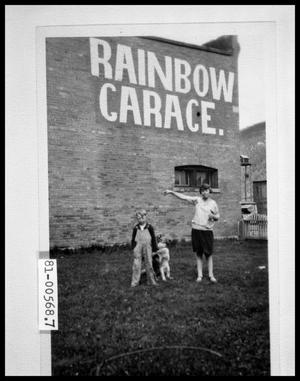 Primary view of object titled 'Children and Dog in Front of the Rainbow Garage'.
