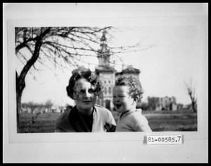 Primary view of object titled 'Woman and Child in front of Courthouse'.
