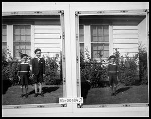 Primary view of object titled 'Two Children in Back Yard; Child in Back Yard'.
