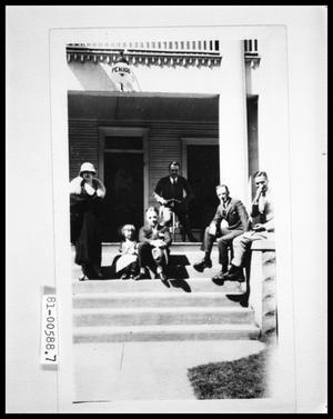 Primary view of object titled 'Group Sitting on Front Porch Steps'.