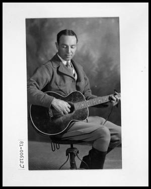 Primary view of object titled 'V. C. Bud Perini Playing Guitar'.