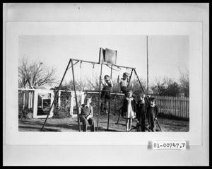 Primary view of object titled 'Children on Swingset in Backyard'.