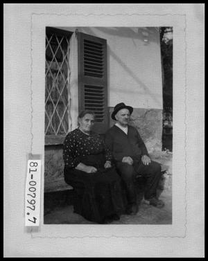 Primary view of object titled 'Older Couple on Bench Outside Building'.