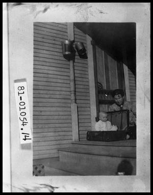 Primary view of object titled 'Mother and Child on Front Porch'.
