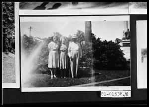 Primary view of object titled 'Women and Man in Yard'.