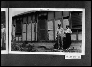 Primary view of object titled 'Man and Woman in Front of House'.