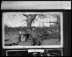 Primary view of object titled 'Man Seated in Yard'.