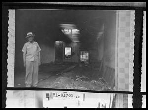 Primary view of object titled 'Man Inside Ruined Store'.