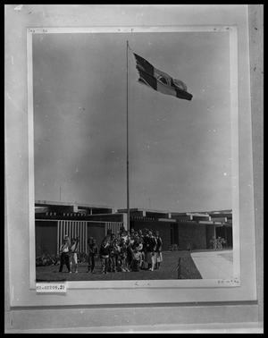 Primary view of object titled 'Students Standing Under Flag'.