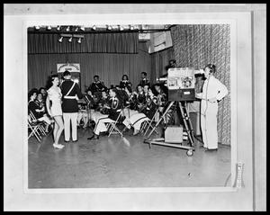 Primary view of object titled 'Twirler and Band on Camera'.
