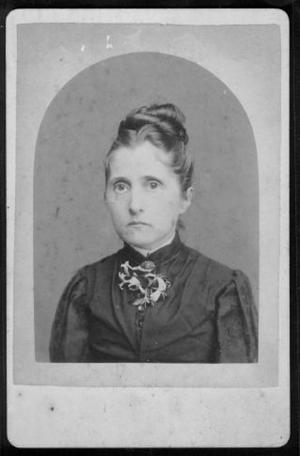 Primary view of object titled '[A young woman with dark hair who is wearing a dark-colored dress.]'.