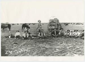 [Photograph of Men Sitting Behind a Chuck Wagon]