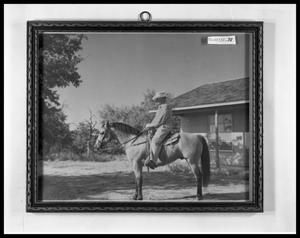 Primary view of object titled 'Man on Horse in Front of Ranch House'.