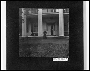 Primary view of object titled 'Lady in Front of Large House'.