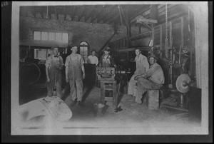 [Photograph of People in Machine Shop]