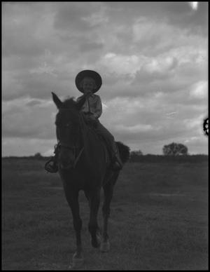 Primary view of object titled '[Photograph of a Girl Riding a Horse]'.