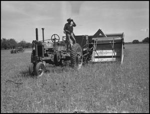 Primary view of object titled '[Photograph of a Man on a Tractor]'.