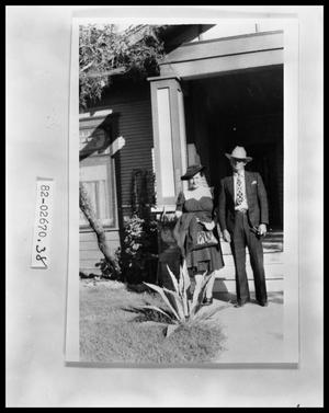 Primary view of object titled '[Photograph of a Man and Woman by Front Porch]'.