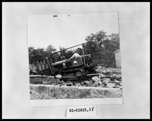 Primary view of object titled 'Bulldozing Burned Ruins'.