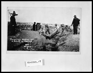 Primary view of object titled 'Throwing Bodies into Common Grave'.