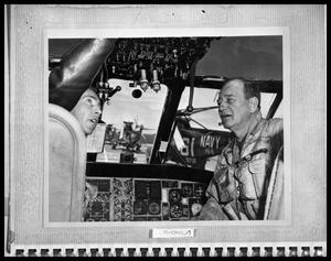 Primary view of object titled 'Man With Officer in Aircraft Cockpit'.