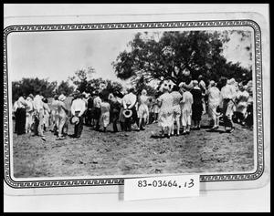 Primary view of object titled 'Congregation Watching River Baptism'.