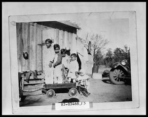 Primary view of object titled 'Children with Wagon in Yard'.
