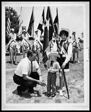 Primary view of object titled 'Man and Boy with Horse Flag Squad'.