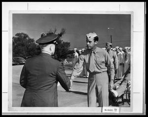 Primary view of object titled 'Officers Shaking Hands'.