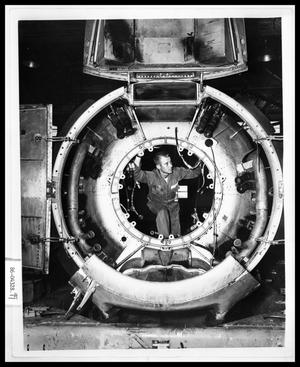 Primary view of object titled 'Man Inside Plane Engine'.