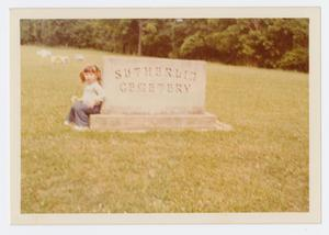 Primary view of object titled '[Child at Sutherlin Cemetery]'.