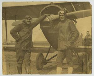 Primary view of object titled '[Lieutenant Cole and Sergeant Fuller Leaning on a Biplane]'.